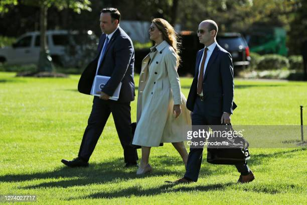 White House Deputy Chief of Staff Dan Scavino, Counselor to the President Hope Hicks and Senior Policy Advisor Stephen Miller walk across the South...