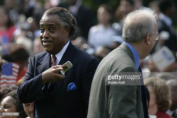 White House Deputy Chief of Staff Karl Rove and the Rev Al Sharpton greet one another before US President George W Bush signed The Fannie Lou Hamer...
