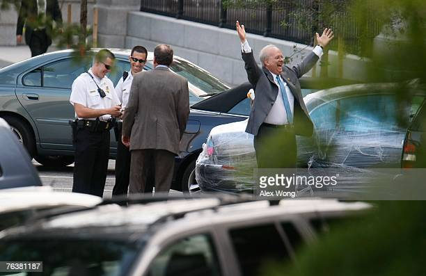 White House Deputy Chief of Staff Karl Rove celebrates after he handed Al Hubbard Director of National Economic Council to two Secret Service...