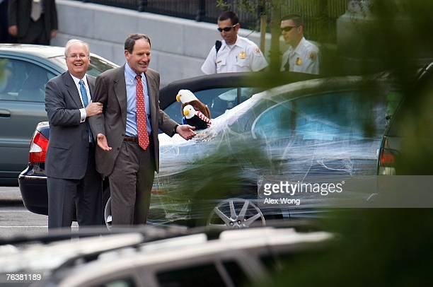 White House Deputy Chief of Staff Karl Rove grabs Al Hubbard Director of National Economic Council after he found his vehicle covered in plastic wrap...