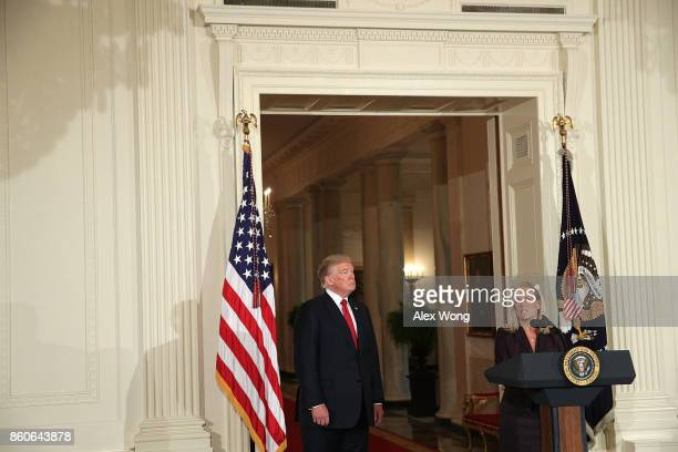 White House Deputy Chief of Staff Kirstjen Nielsen speaks as U.S. President Donald Trump listens during a nomination announcement at the East Room of...