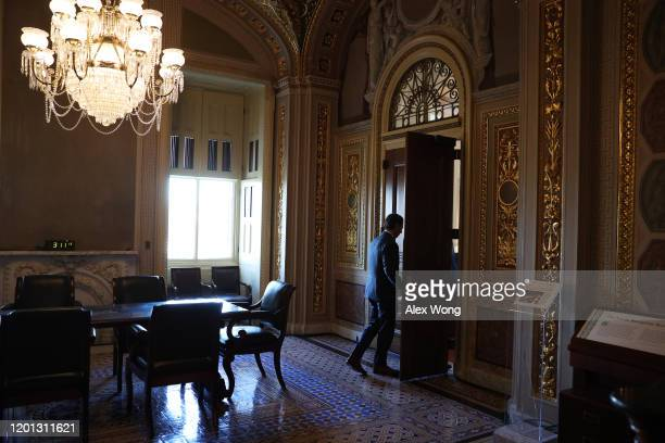 White House Deputy Press Secretary Hogan Gidley enters a prep room for the defense team outside the Senate chamber during the Senate impeachment...