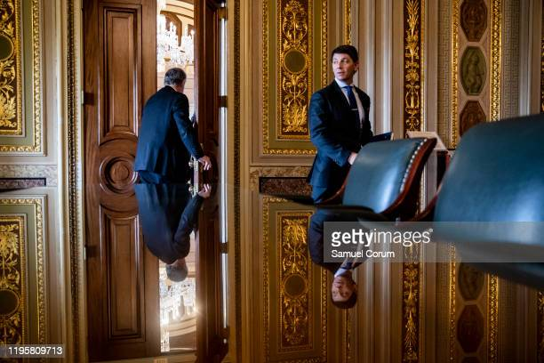 White House Deputy Press Secretary Hogan Gidley leaves after talking with Representative Mark Meadows outside of President Donald Trumps defense...