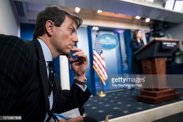 White House deputy press secretary Hogan Gidley listens as White House press secretary Sarah Huckabee Sanders speaks at the daily press briefing at...