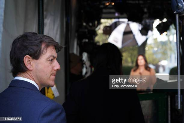 White House Deputy Press Secretary Hogan Gidley stands by as Press Secretary Sarah Huckabee Sanders is interviewed by FOX News outside the West Wing...