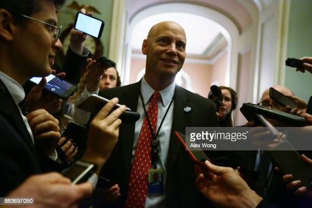White House Director of Legislative Affairs Marc Short is surrounded by members of the media at the Capitol December 1 2017 in Washington DC Senate...