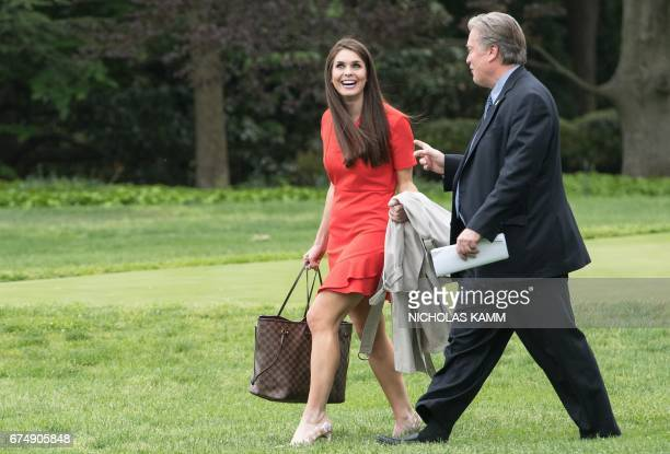 White House Director of Strategic Communications Hope Hicks and Chief Strategist Steve Bannon walk to board Marine One as US President Donald Trump...