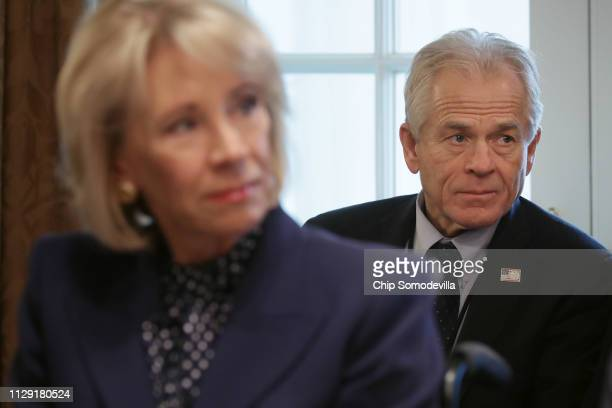 White House Director of the Office of Trade and Manufacturing Policy Peter Navarro listens to US President Donald Trump talk to reporters during a...
