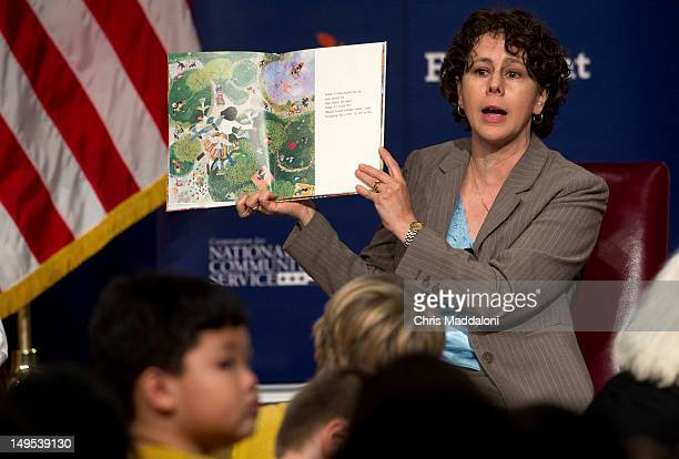 White House Domestic Policy Council Director Cecilia Munoz reads 'Abuela' to local school children during an Education Department summer enrichment...