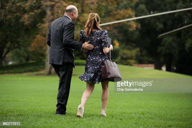White House Economic Council Director Gary Cohn and Strategic Communications Director Hope Hicks leave the White House October 11 2017 in Washington...