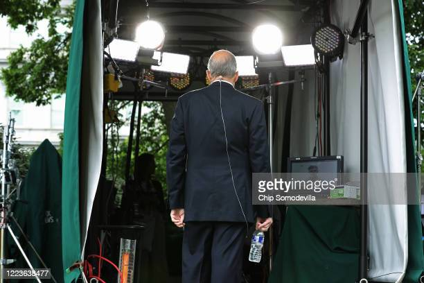 White House Economic Council Director Larry Kudlow talks to FOX News outside the White House on the morning that the Labor Department announced that...