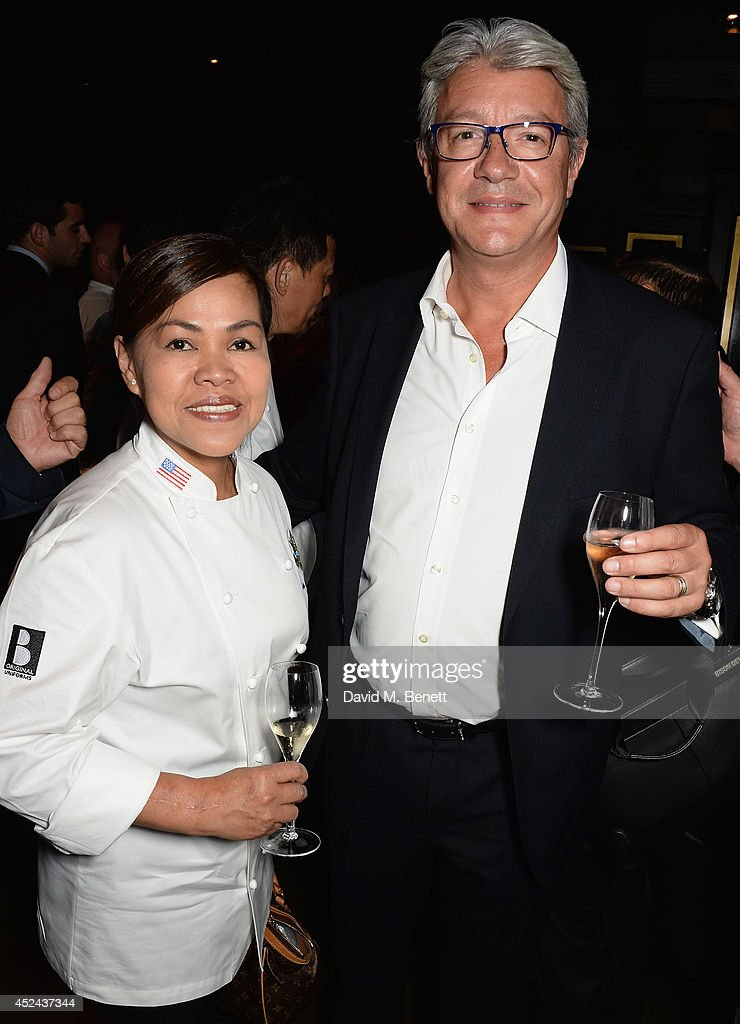 White House Executive Chef Cristeta Pasia Comerford and Executive Vice President of Restaurants Hakkasan Group Didier Souillat attends Le Club des Chefs des Chefs dinner at Hakkasan Hanway Place on July 20, 2014 in London, England.