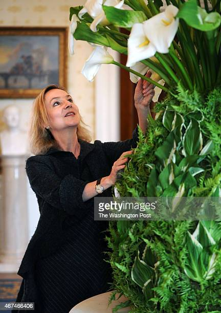 White House Florist Laura Dowling puts finishing touches on an enormous pinapple arrangement made from hosta and lillies as she prepares the floral...