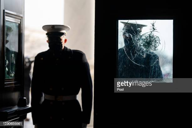 White House Marine sentries rehearse the arrival of President-elect Joe Biden next to a window smashed by insurgents during their incursion into the...