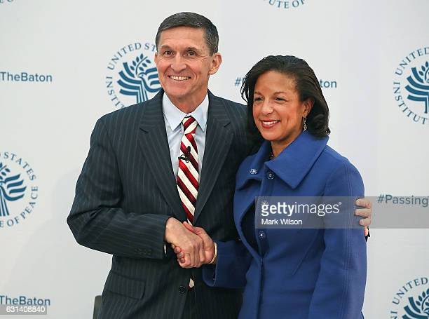 White House National Security Adviser Susan Rice shakes hands with incoming White House National Security Advisor Gen Michael Flynn during the 2017...