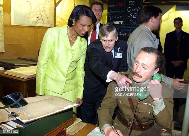 White House National Security Advisor Condoleezza Rice is guided through the map room of Winston Churchill's Cabinet War Rooms in London, 19 July...