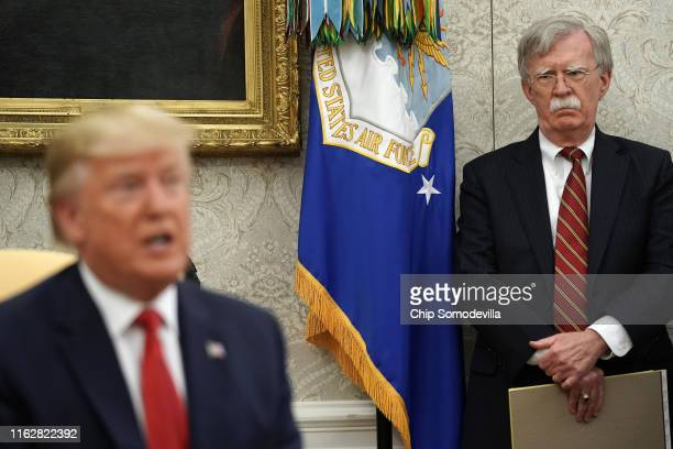 White House National Security Advisor John Bolton listens to U.S. President Donald Trump as he and Dutch Prime Minister Mark Rutte talk to reporters...