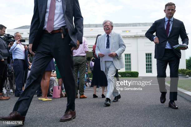 White House National Security Advisor John Bolton walks out of the White House West Wing before a FOX News interview July 31, 2019 in Washington, DC....
