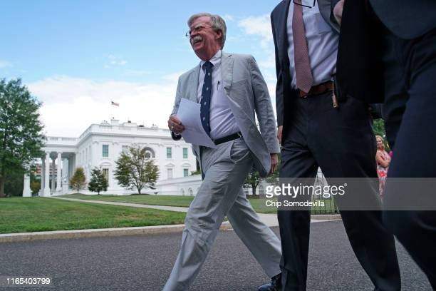 White House National Security Advisor John Bolton walks out of the White House West Wing before a FOX News interview July 31 2019 in Washington DC...