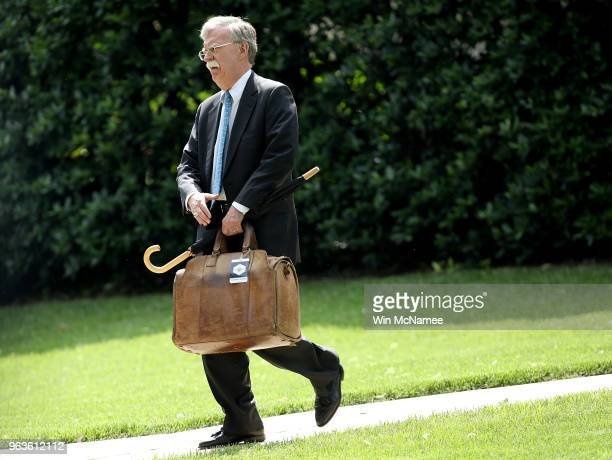 White House national security advisor John Bolton walks to Marine One while US President Donald Trump was departing the White House May 29 2018 in...