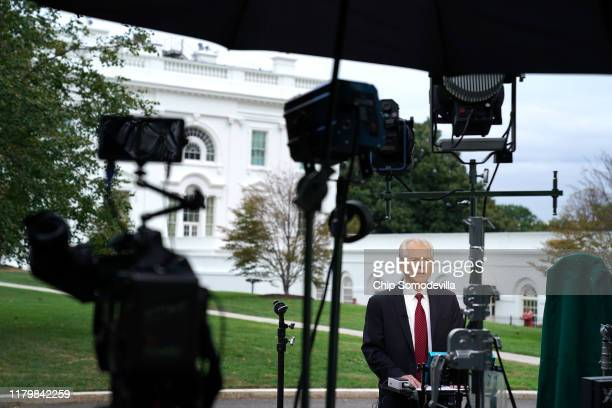 White House National Trade Council Director Peter Navarro is interviewed by Fox Business Network outside the White House October 08 2019 in...