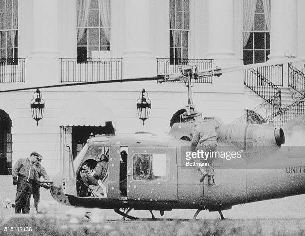 White House officials look over a Bell AH1 Huey on the South Lawn of the White House Earlier in the day Private First Class Robert K Preston stole...