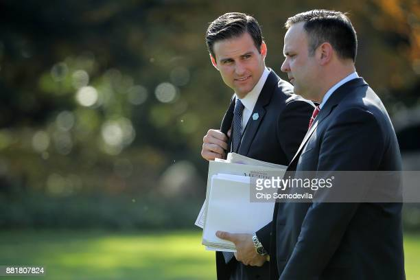 White House Personal Aide to the President John McEntee and White House Director of Social Media Dan Scavino leave the White House with US President...