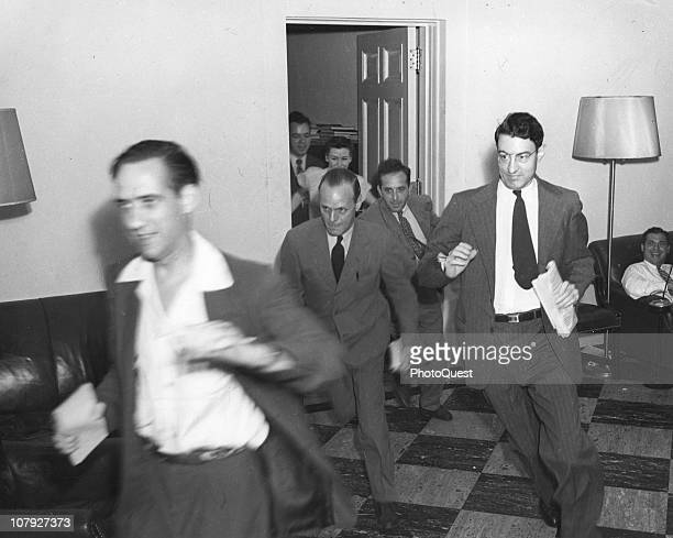 White House Press Corps journalists scramble for telephones following the announcement of Japan's WW2 surrender Washington DC August 15 1945