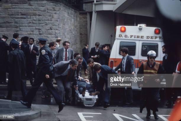 White House Press Secretary James Brady , on stretcher, is carried to an ambulance outside the Washington Hilton Hotel, Washington DC March 30, 1981....