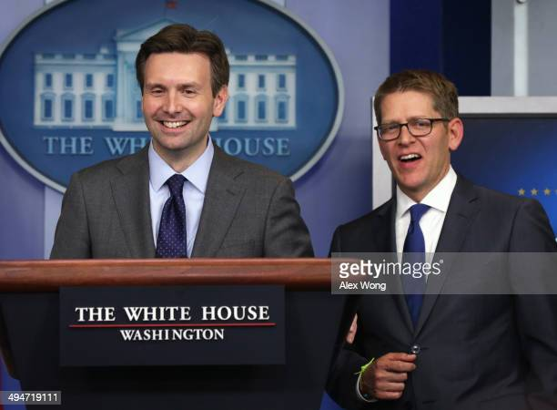 White House Press Secretary Jay Carney and Press Secretary Josh Earnest speak to members of the media during the White House daily briefing 2014 in...