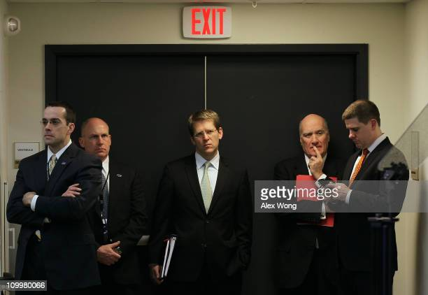 White House Press Secretary Jay Carney and White House Chief of Staff William Daley listen as U.S. President Barack Obama holds a news conference at...