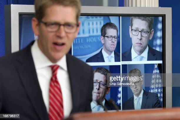 White House Press Secretary Jay Carney displays photographs of himself from Tuesday's briefing before taking questions from reporters in the Brady...