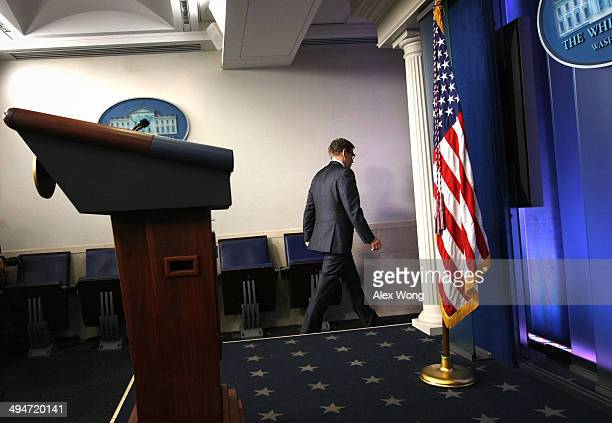 White House Press Secretary Jay Carney leaves the James Brady Press Briefing Room of the White House after U.S. President Barack Obama announced the...