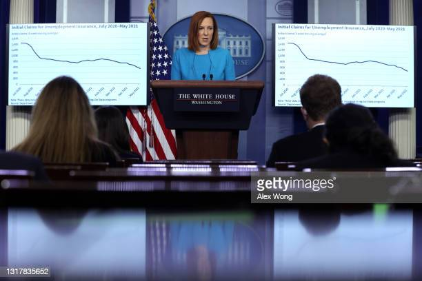 White House Press Secretary Jen Psaki speaks as a chart of initial claims for unemployment insurance from July, 2020 to May, 2021 is shown on a...