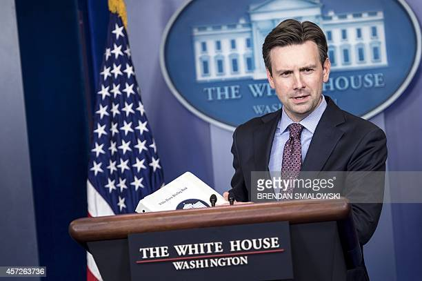White House Press Secretary Josh Earnest arrives for a daily briefing at the White House October 15 2014 in Washington DC World health authorities...