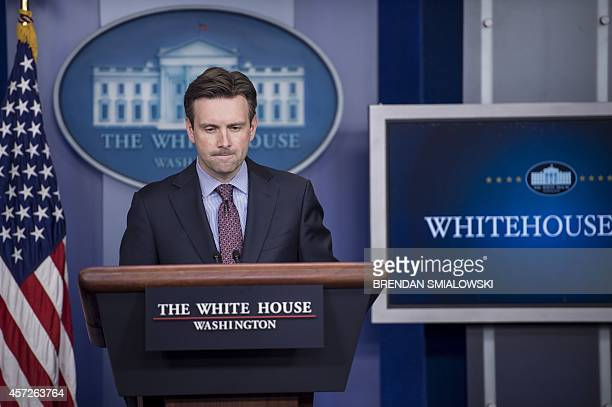 White House Press Secretary Josh Earnest speaks during a daily briefing at the White House October 15 2014 in Washington DC World health authorities...