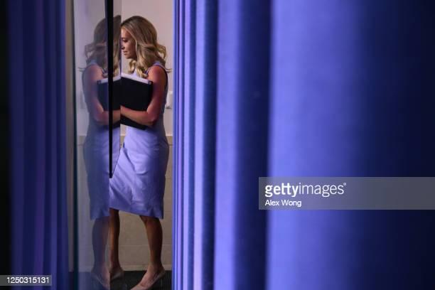 White House Press Secretary Kayleigh McEnany arrives at a news briefing at the James Brady Press Briefing Room of the White House June 17 2020 in...