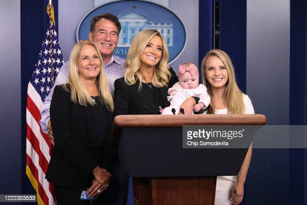 White House Press Secretary Kayleigh McEnany holds her five-month-old daughter Blake Gilmartin while posing for photographs with her parents Mike and...