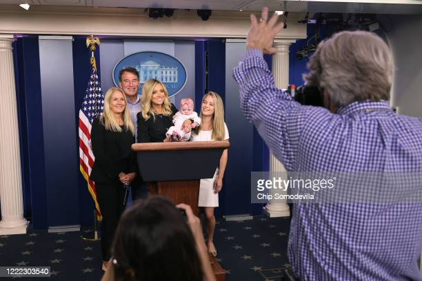 White House Press Secretary Kayleigh McEnany holds her fivemonthold daughter Blake Gilmartin while posing for photographs with her parents Mike and...