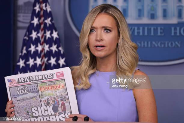 White House Press Secretary Kayleigh McEnany holds up a copy of the New York Post during a news briefing at the James Brady Press Briefing Room of...