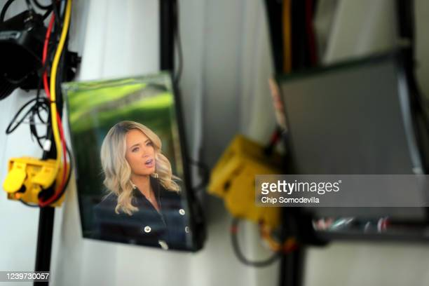 White House Press Secretary Kayleigh McEnany is reflected in television screens as she is interviewed for the Fox & Friends program outside the White...