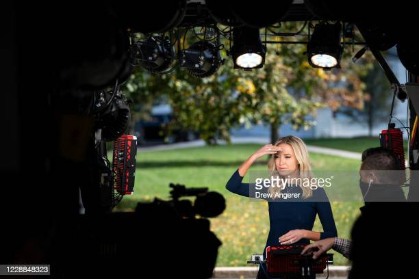 White House Press Secretary Kayleigh McEnany prepares to do a television interview outside the West Wing of the White House on October 2, 2020 in...