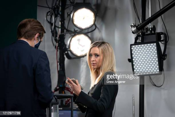White House Press Secretary Kayleigh McEnany prepares to do a television interview with Fox News outside the White House on May 14, 2020 in...