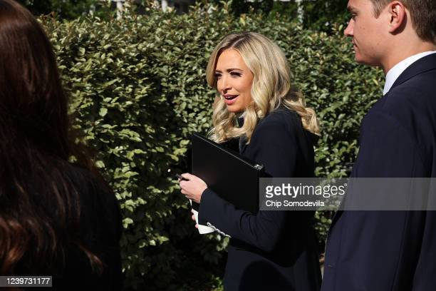 White House Press Secretary Kayleigh McEnany returns to the West Wing after an interview with the Fox & Friends program outside the White House June...