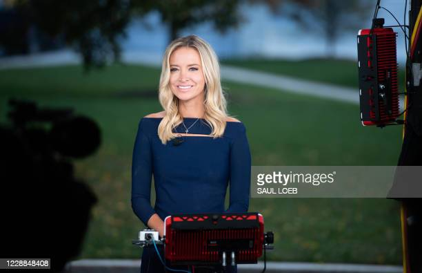 White House Press Secretary Kayleigh McEnany speaks during a television interview at the White House in Washington, DC, October 2, 2020. - Donald...