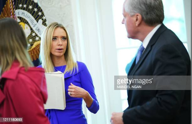 White House Press Secretary Kayleigh McEnany speaks to White House Chief of Staff Mark Meadows as US President Donald Trump meets Florida Governor...