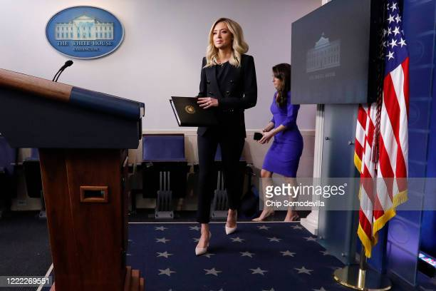White House Press Secretary Kayleigh McEnany steps onto the podium for her first oncamera news conference in the James Brady Press Briefing Room at...