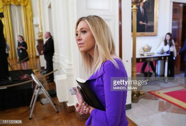 White House Press Secretary Kayleigh McEnany waits for the start of an event on protecting small businesses through the paycheck protection program...