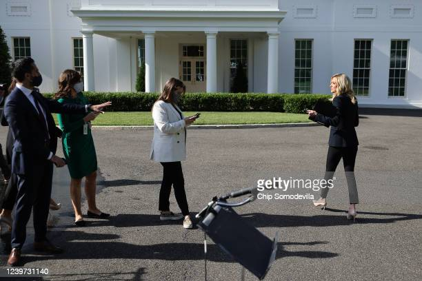 White House Press Secretary Kayleigh McEnany walks past reporters following an interview with the Fox & Friends program outside the White House June...