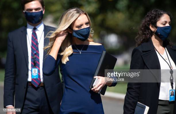 White House Press Secretary Kayleigh McEnany walks to speak to members of the media at the White House in Washington, DC, October 2, 2020. - Donald...
